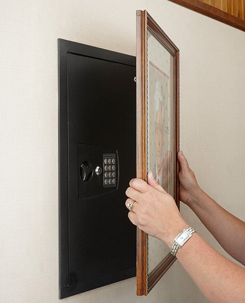 Photo Of A Wall Safe Hidden Behind A Framed Picture.